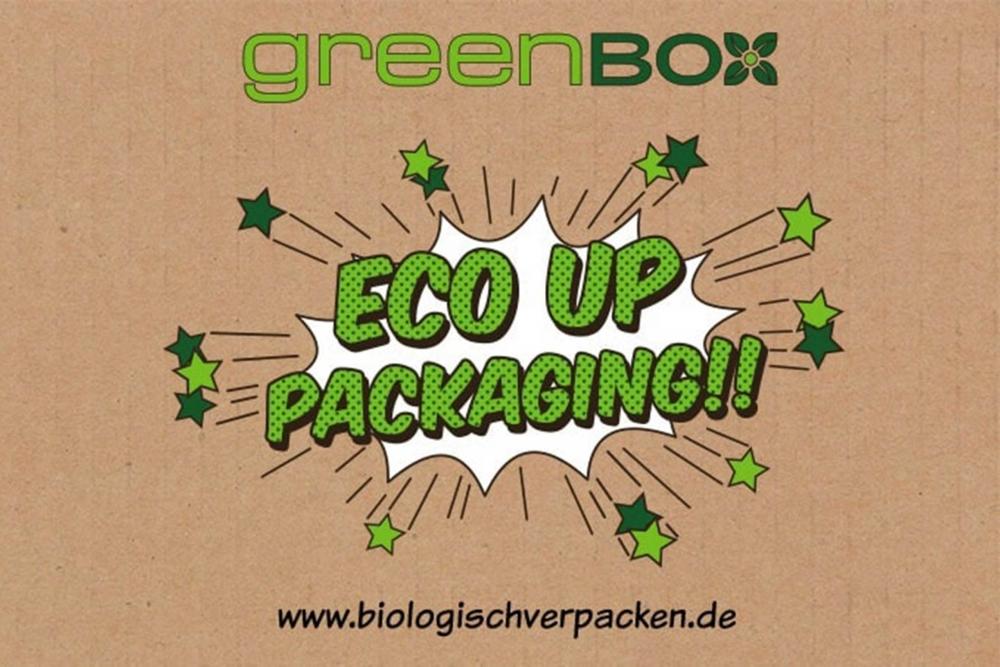 """Das Logo von greenbox mit dem Claim """"Eco Up Packaging!"""""""
